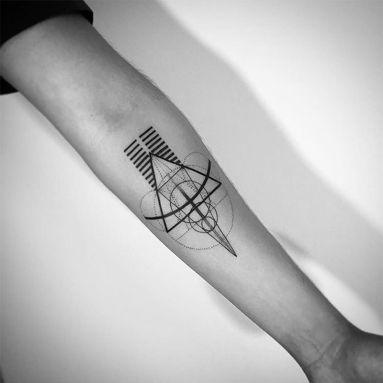 Mystical black ink geometrical style forearm tattoo