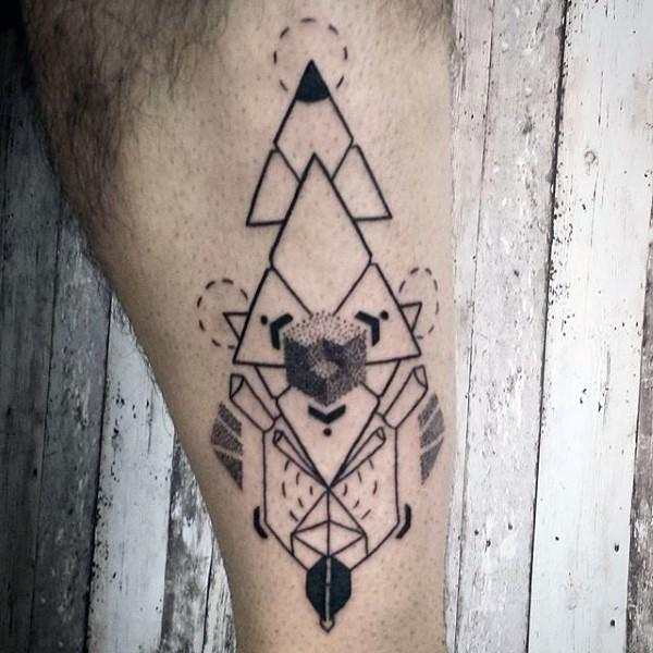 Mystical black ink geometrical style tattoo on leg