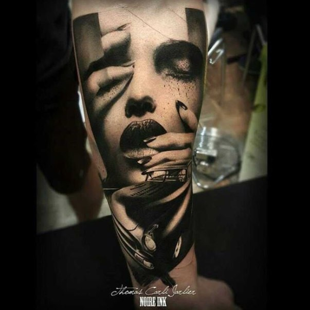 Mystical black ink hand tattoo of woman face with classic car