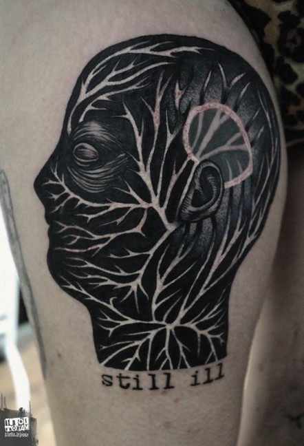 Mystical black ink human head with ornaments tattoo stylized with lettering