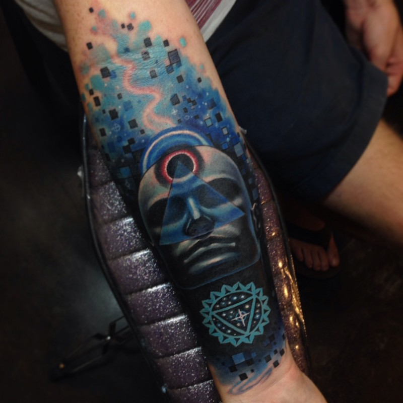 Mystical colored forearm tattoo of human face with symbols