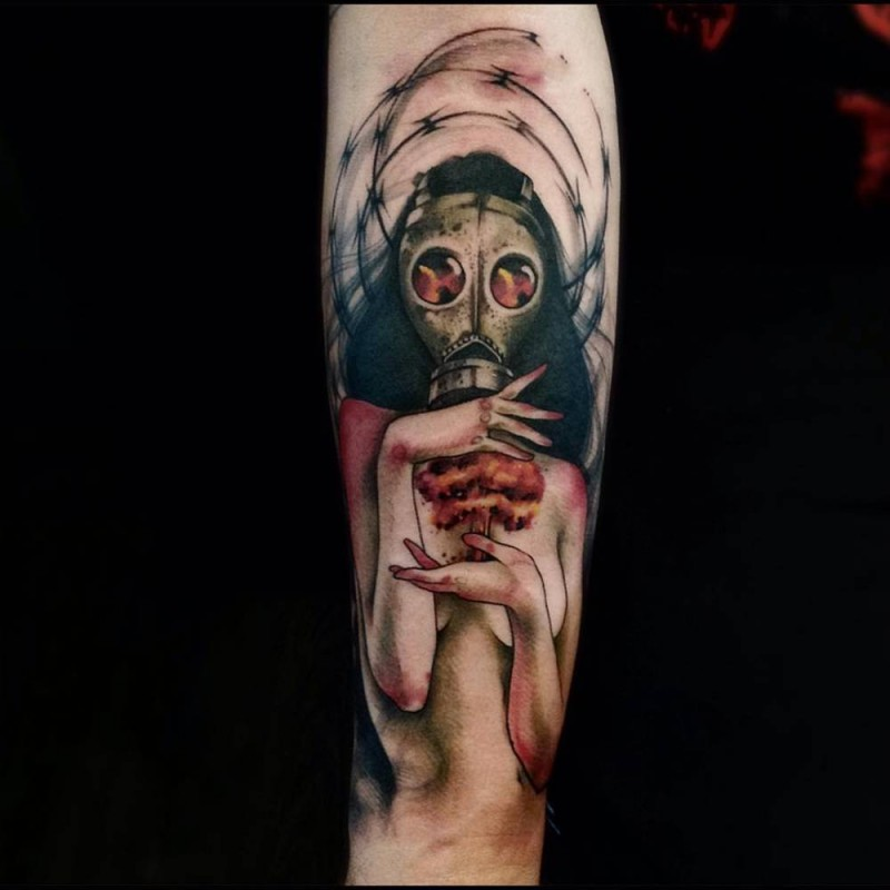 Mystical colored forearm tattoo of woman in gas mask