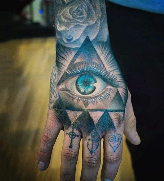 Mystical colored hand tattoo of human eye in triangle