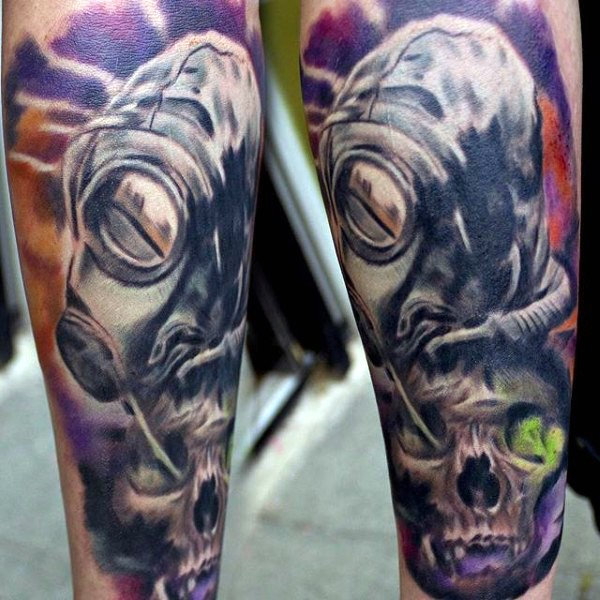Mystical colored illustrative style forearm tattoo of man in gas mask and human skull