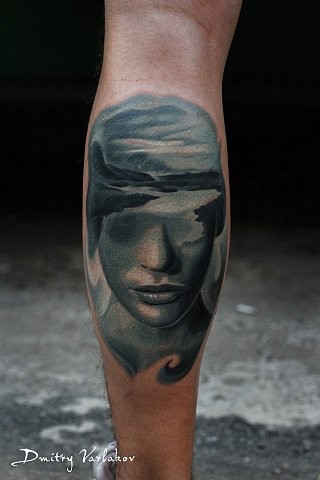 Mystical colored leg tattoo of woman face