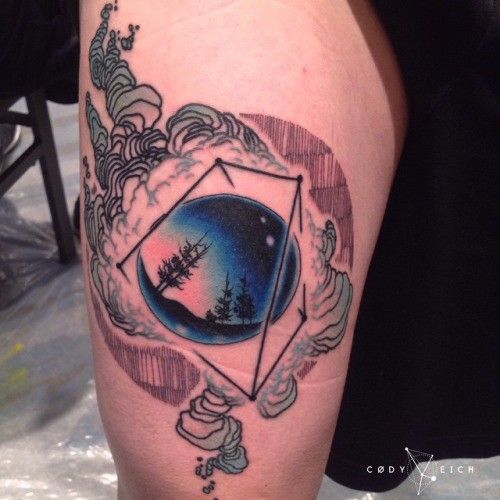 Mystical colored thigh tattoo of black orb with dark forest