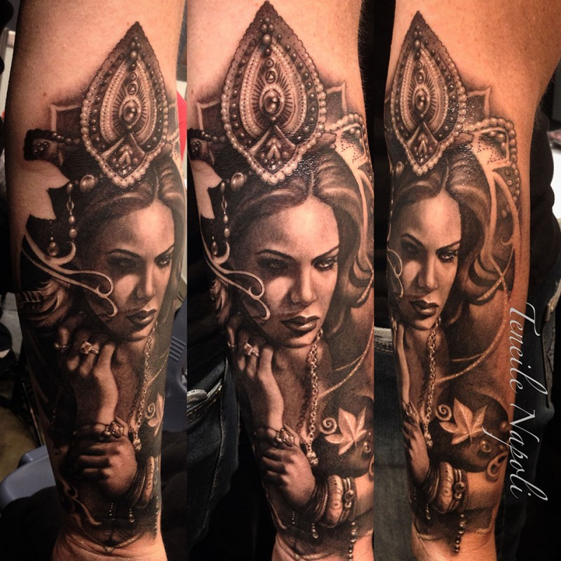 Mystical creepy looking forearm tattoo of woman with crown