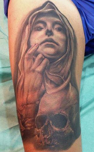 Mystical designed black and white creepy woman with skull tattoo on thigh