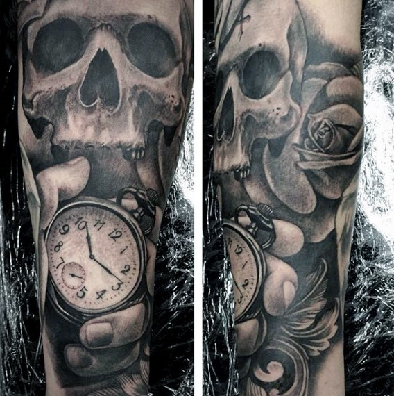 Mystical designed black and white skull with flower and old clock tattoo on arm
