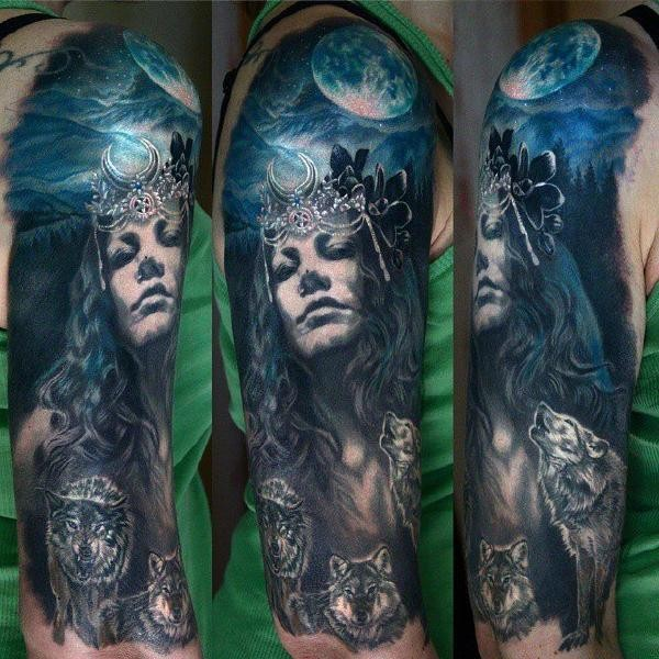 Mystical detailed and colored woman with crown tattoo on shoulder stylized with night sky and wolves