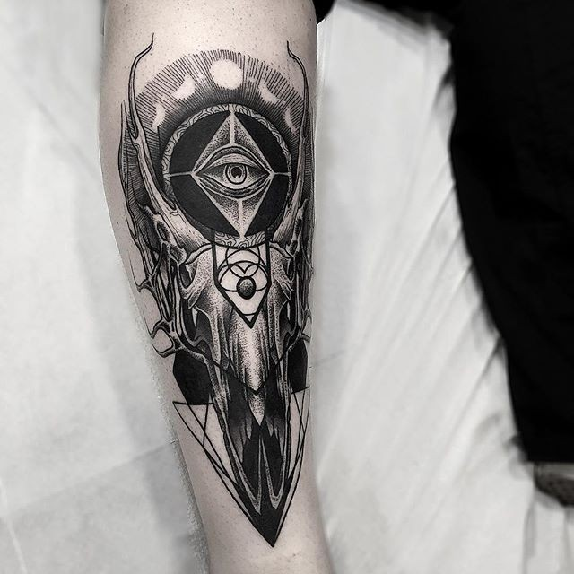 Mystical dot style leg tattoo of animal skull with mystical eye