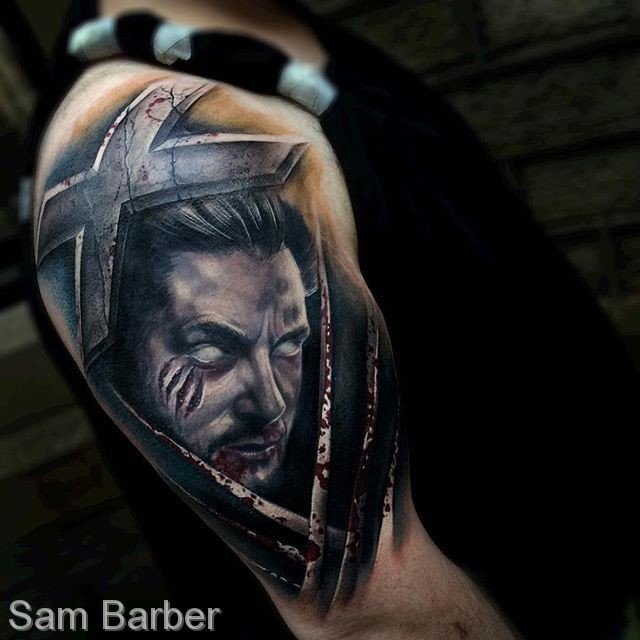 Mystical illustrative style shoulder tattoo of demonic man with cross