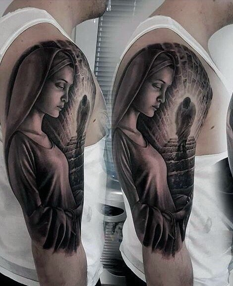 Mystical looking black ink shoulder tattoo of religious woman with strange figure