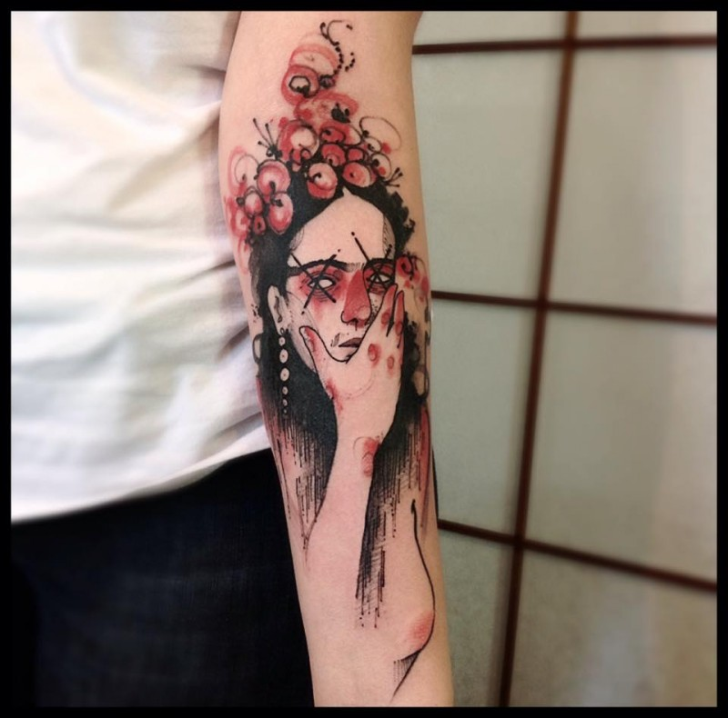 Mystical looking colored forearm tattoo of woman with flowers