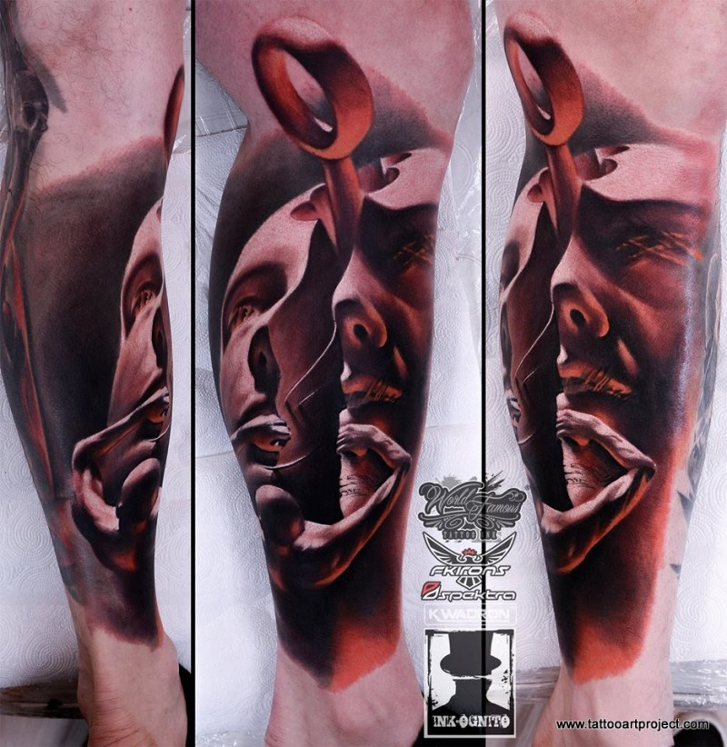 Mystical looking colored leg tattoo of amazing face with loop