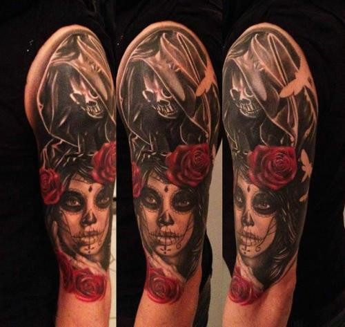 Mystical looking colored shoulder tattoo of Mexican woman portrait and Death skeleton