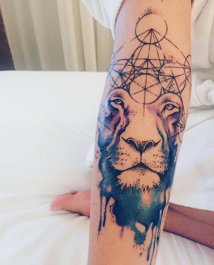 Mystical looking colored tattoo of lion head with geometrical figures