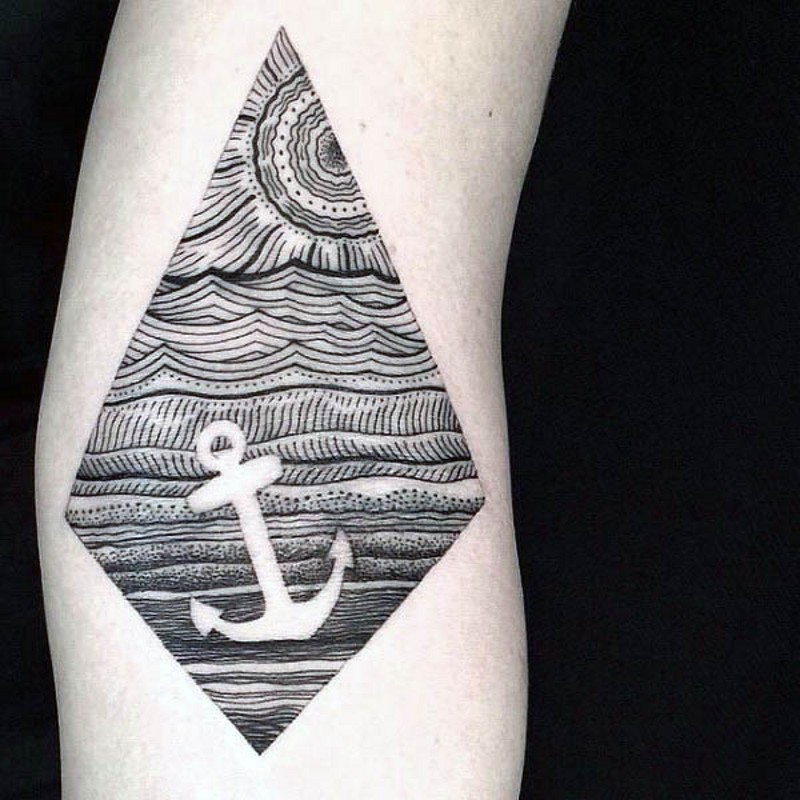 Mystical nautical themed white anchor in sea tattoo on arm