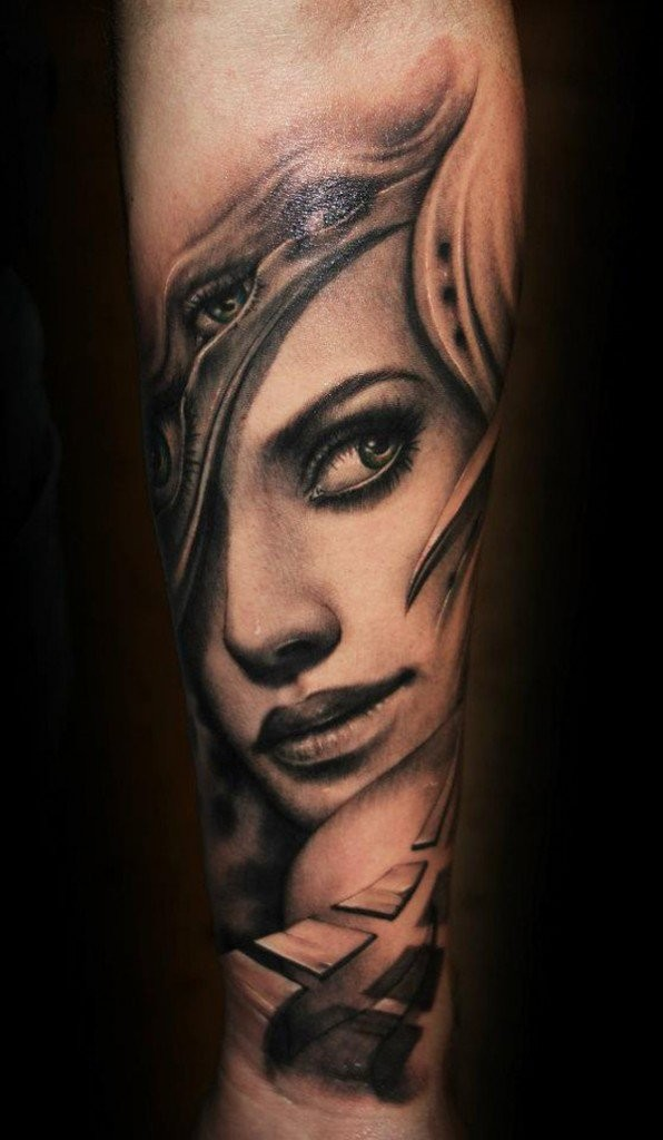 Mystical old female warrior with nice eyes tattoo on arm