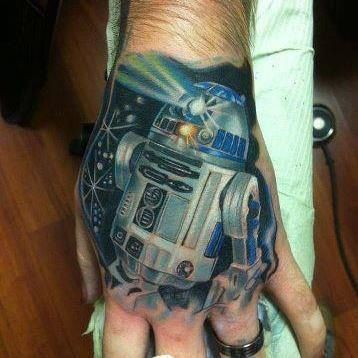 Mystical R2D2 Star wars hero colored super detailed tattoo on hand