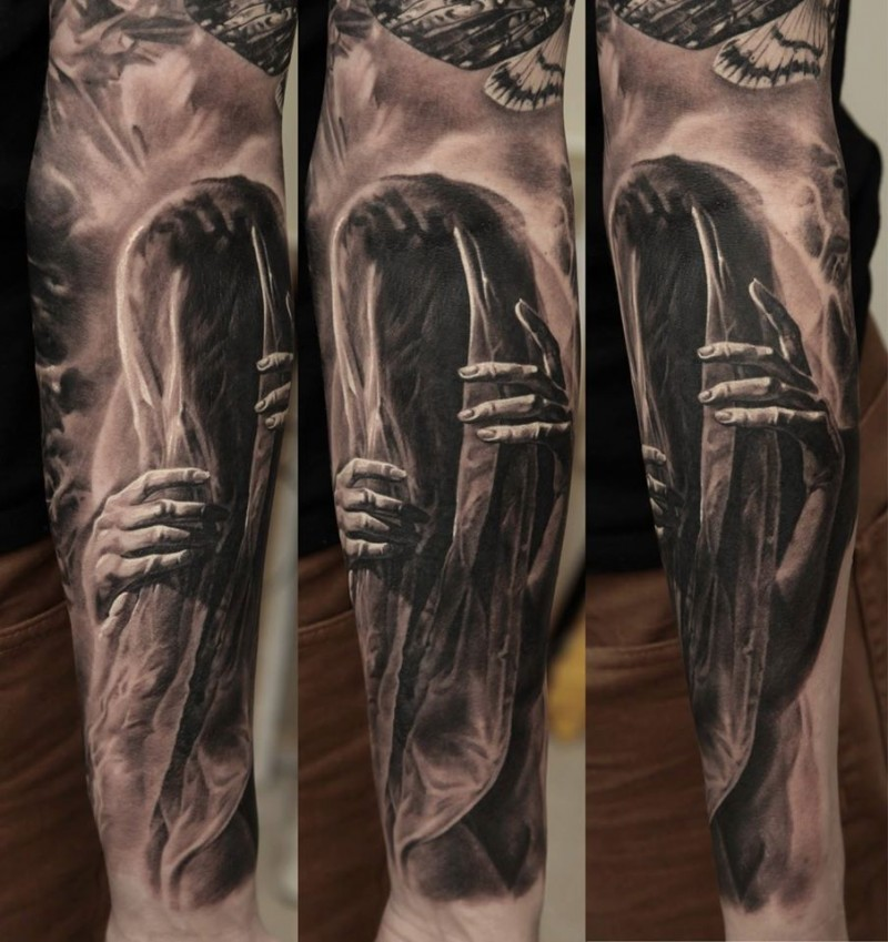 Mystical realism style forearm tattoo of mystical ghost