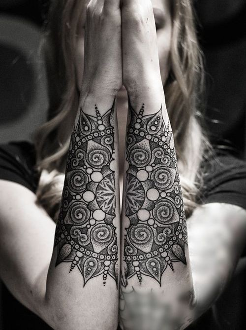 Mystical style black and white flower shaped tattoo on arms