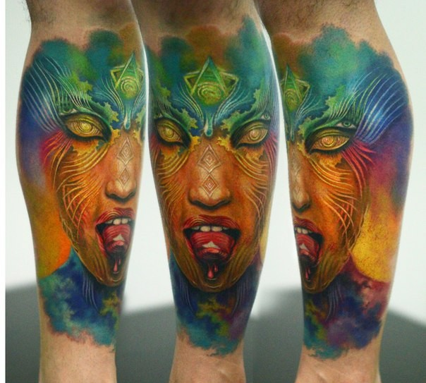 Mystical terrifying looking colored tattoo of demonic woman face