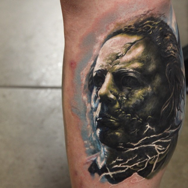 Mystical zombie like colored monster tattoo on leg