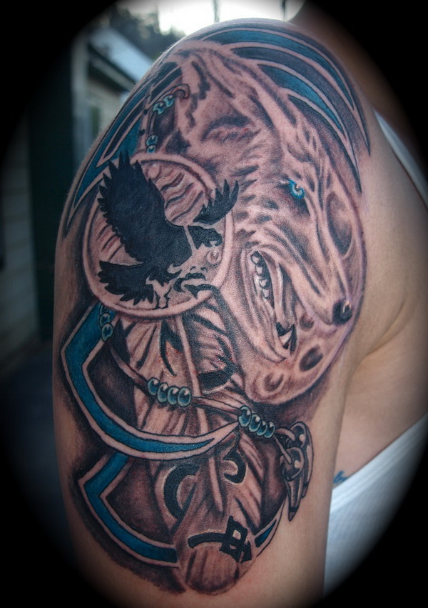 Tribal indian wolf tattoo on shoulder