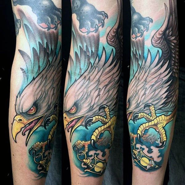 Natural colored old school eagle tattoo on forearm with street lighter