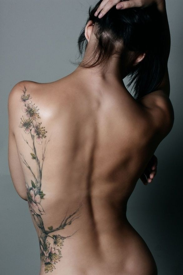 Natural colored very detailed big floral tattoo on shoulder and thigh