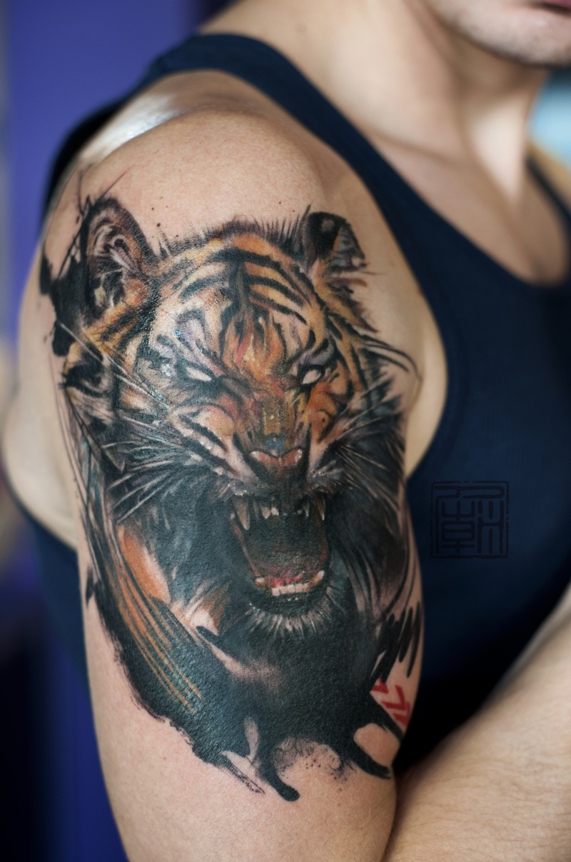Natural looking 3D detailed roaring demonic tiger tattoo on shoulder