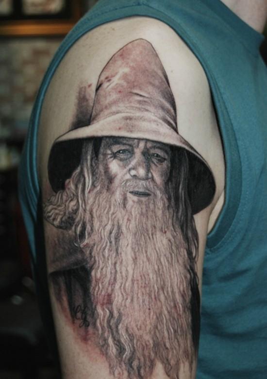 Natural looking 3D like big shoulder tattoo of Gandalf portrait