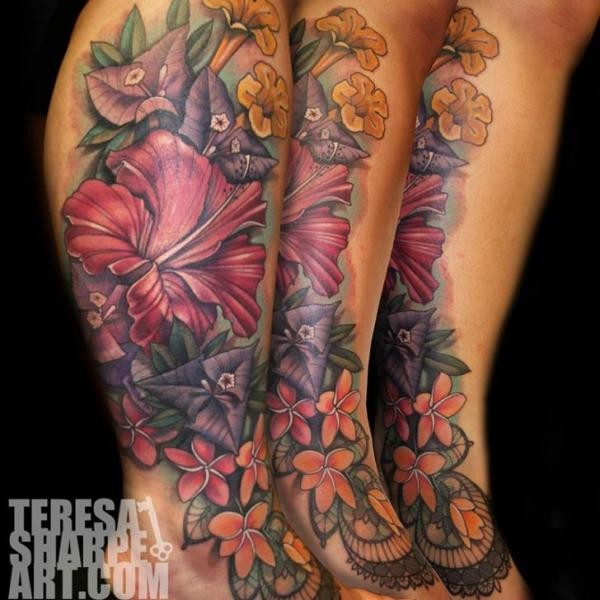 Natural looking beautiful colored various flowers tattoo on leg