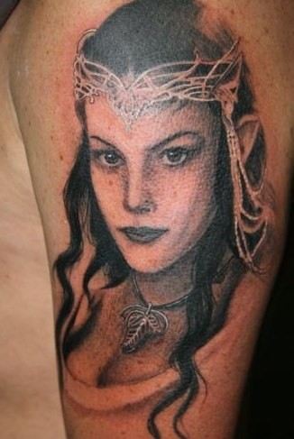 Natural looking beautiful designed Lord of the Rings elf princess portrait tattoo on shoulder area