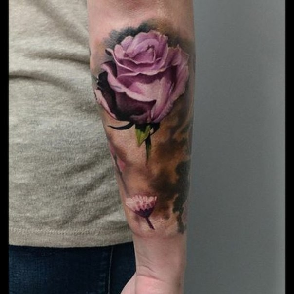 Natural looking beautiful looking arm tattoo of pink rose