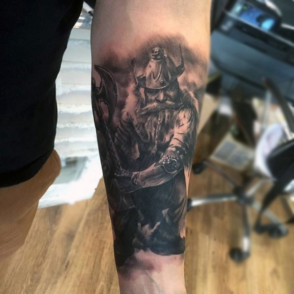 Natural looking black and white medieval fantasy warrior tattoo on forearm