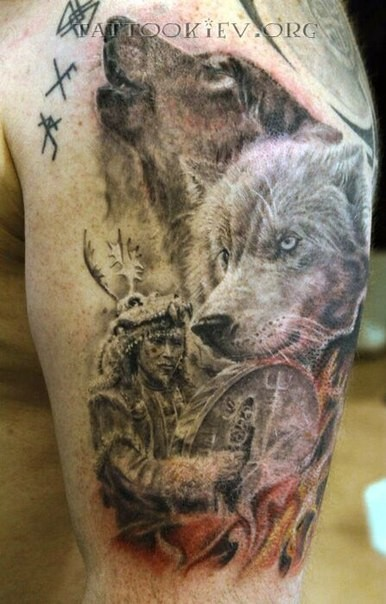 Natural looking black and white old tribal shaman on shoulder tattoo stylized with wolves
