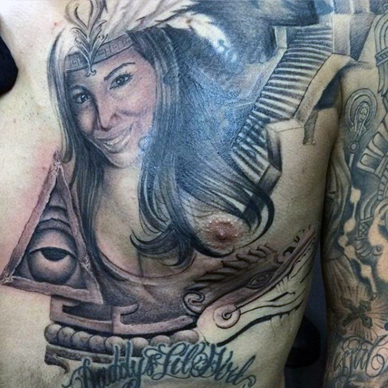 Natural looking black and white tribal woman portrait tattoo on chest with temple