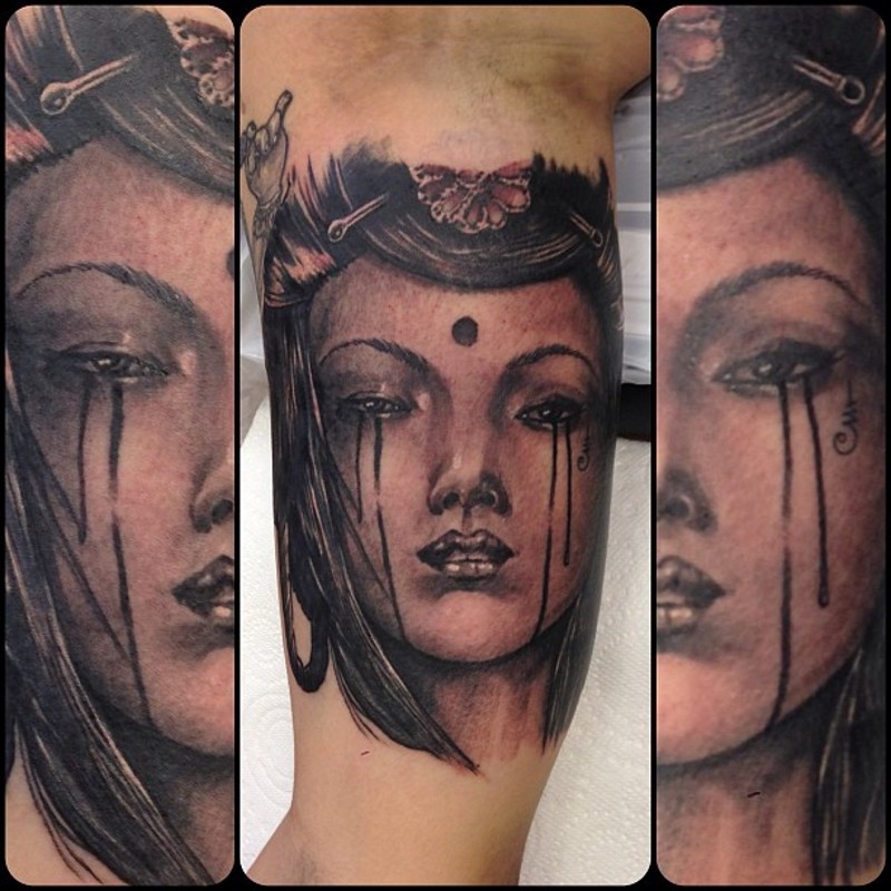 Natural looking black ink arm tattoo of Asian woman portrait