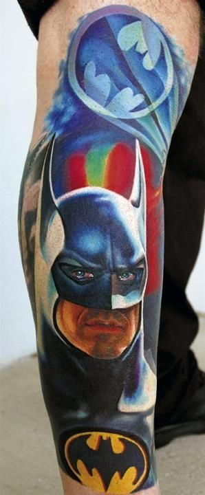 Natural looking colored and detailed Batman with symbol tattoo on leg