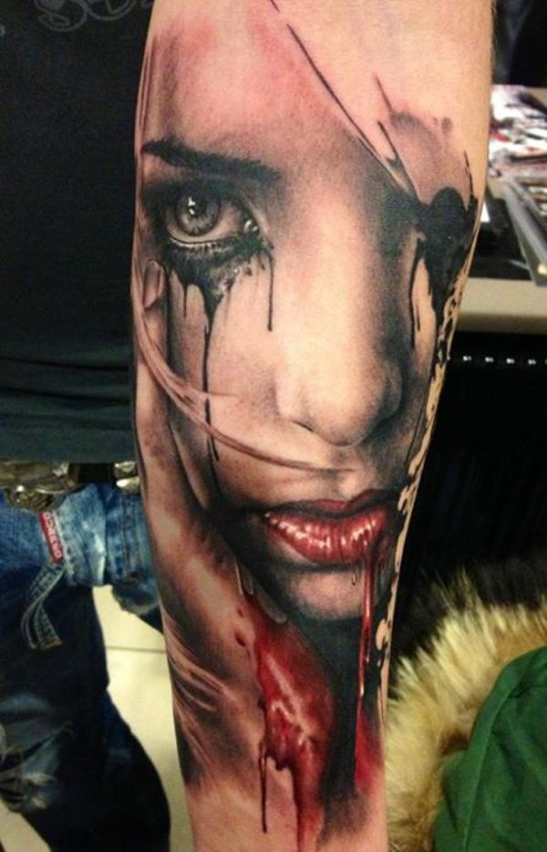 Natural looking colored arm tattoo of crying woman face