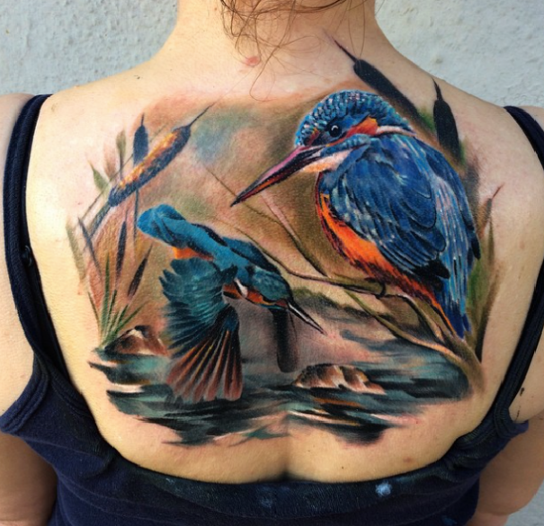 Natural looking colored back tattoo of birds