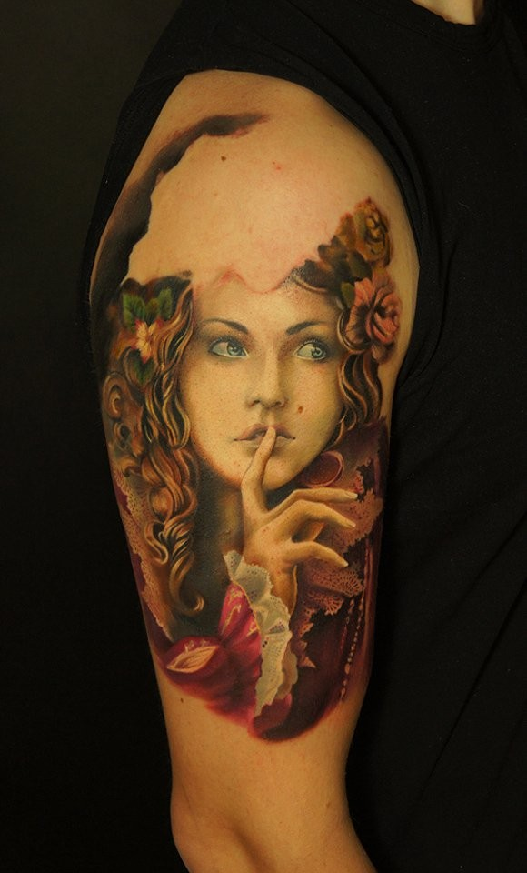 Natural looking colored beautiful woman portrait tattoo on shoulder combined with flowers