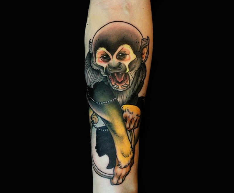 Natural looking colored cute monkey tattoo on forearm