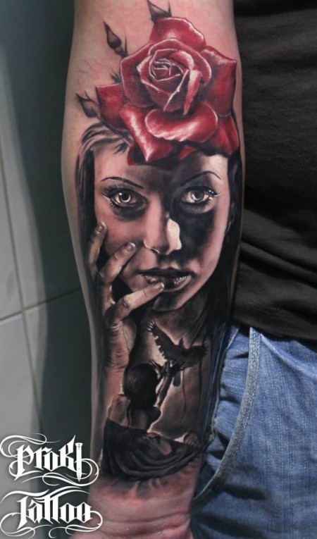 Natural looking colored forearm tattoo of woman face with rose and pigeon