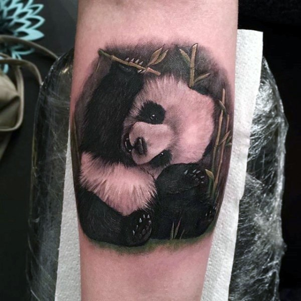 Natural looking colored forearm tattoo of cute little panda
