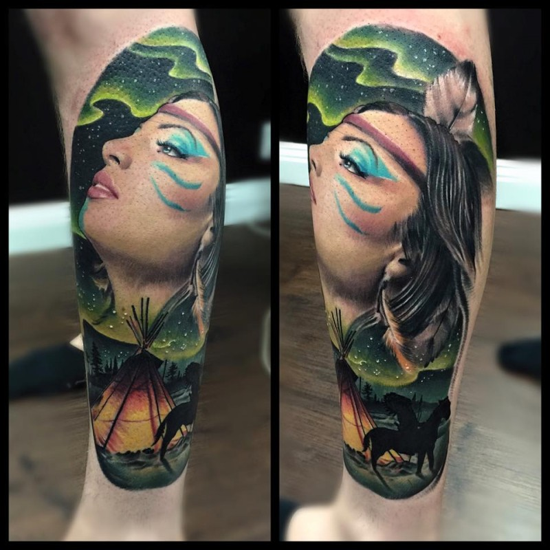 Natural looking colored leg tattoo of Indian woman with feather