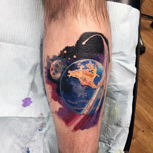 Natural looking colored leg tattoo of Earth planet in space with moon