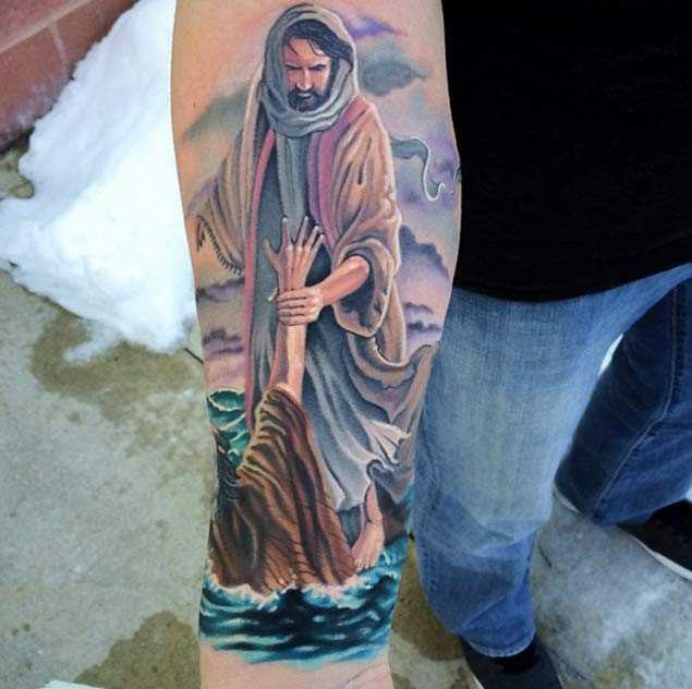 Natural looking colored religious tattoo on forearm